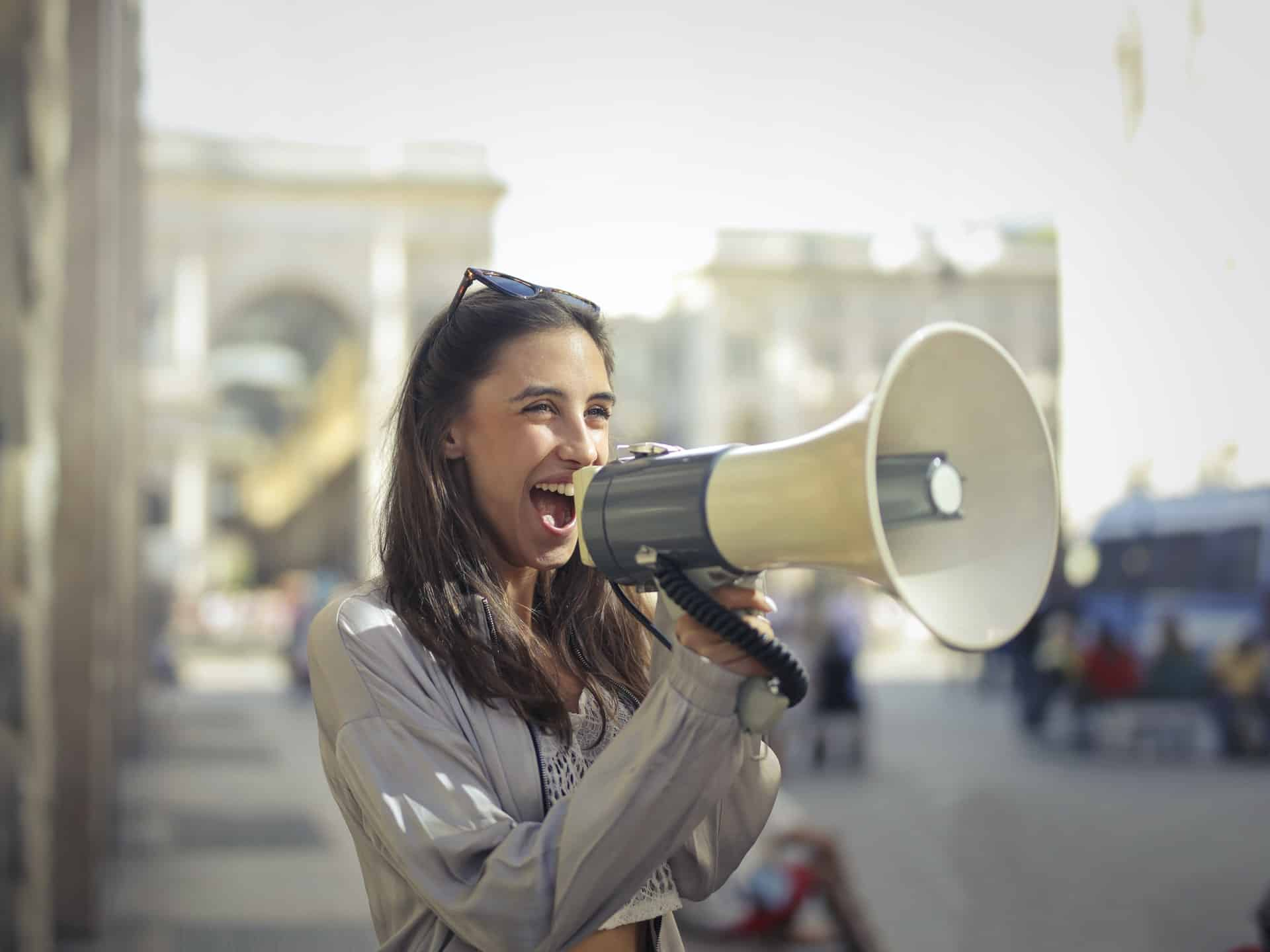 excited woman with bullhorn